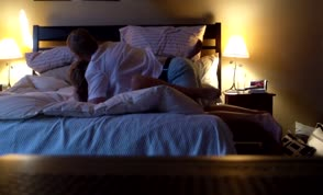 Old amateur couple having sex in a hotel room