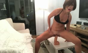 She warms up with dildo before having sex