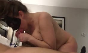 Masked chubby babe sucks dick