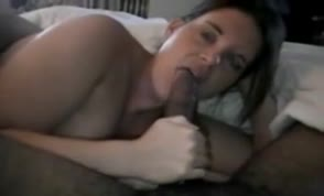 MILF feeding on a large black cock